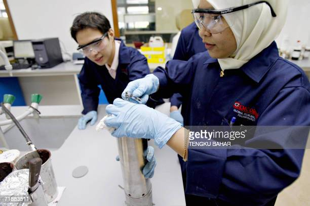 Laboratory technicians prepare a highpressure testing cylinder at a Scomi research development and training centre on the outskirts of Kuala Lumpur...