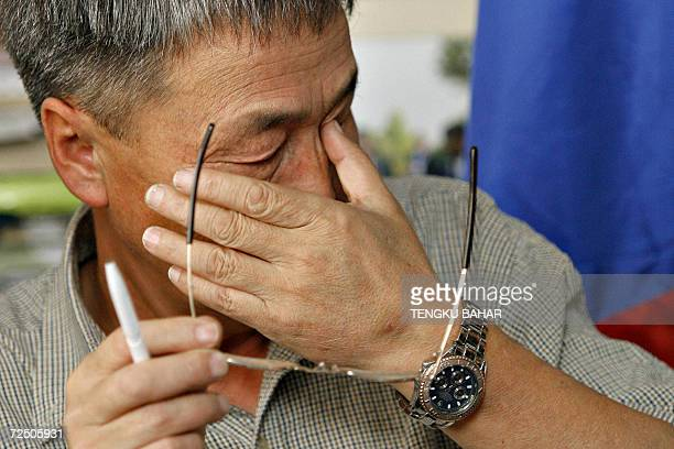 Shaariibuu Setev father of slain Mongolian model Altantuya Shaariibuu wipes away tears during a press conference in Kuala Lumpur 11 November 2006 A...