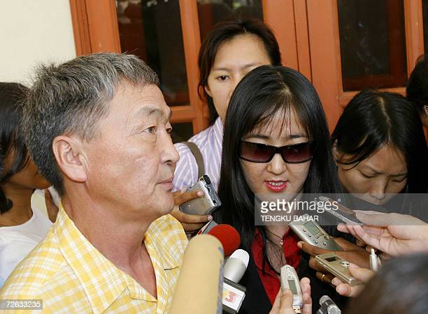 Shaariibuu Setev father of slain Mongolian model Altantuya Shaariibuu talks to journalists outside the Malaysian High Court in Kuala Lumpur 23...