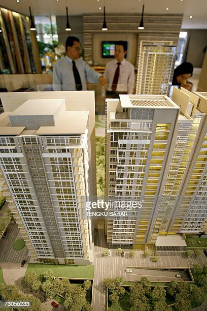 TO GO WITH STORY MALAYSIAPROPERTY A customer talks with a property sales agent while taking a look at a model of a luxury condominium at a property...