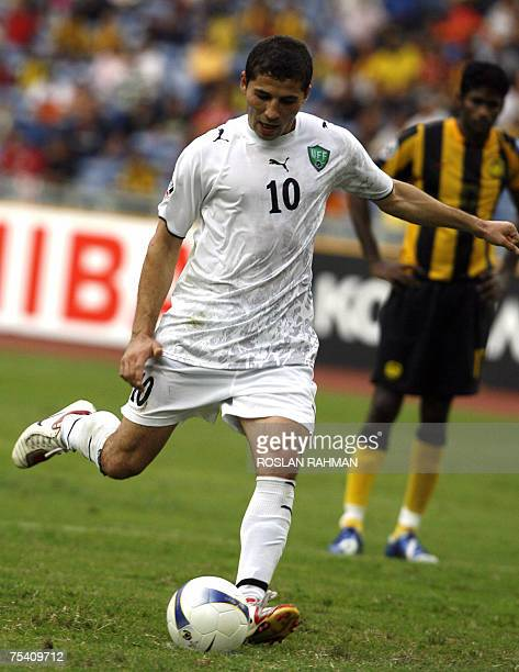 Kuala Lumpur, MALAYSIA: Uzbekistan football Ulugbek Bakaev takes a penalty kick against Malaysia in the group C of the Asian Football Cup 2007 at the...