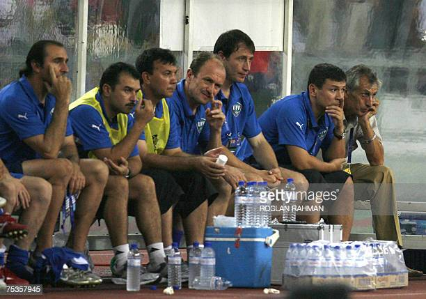Uzbekistan head coach Rauf Inileyev with team members are seen during the Uzbekistan vs Iran in the group C of the Asian Football Cup 2007 at the...