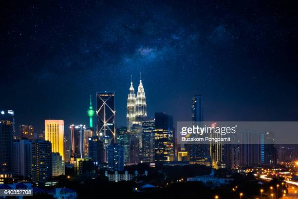 kuala lumpur nightscape with milky way, malaysia - malaysia stock pictures, royalty-free photos & images