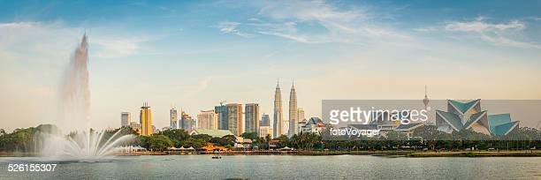 kuala lumpur petronas towers landmark cityscape skyscrapers fountain sunset malaysia - malaysia stock pictures, royalty-free photos & images