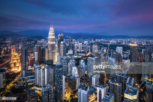 kuala lumpur skyline at dusk - malaysia stock pictures, royalty-free photos & images