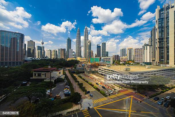 kuala lumpur skyline during blue sky overlooking a busy road intersection - isometric projection stock photos and pictures