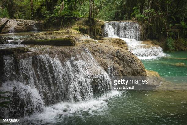 kuang si stacked waterfalls - freshwater stock pictures, royalty-free photos & images