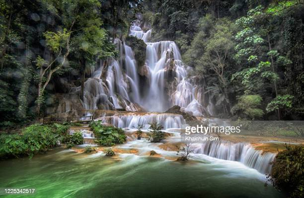 kuang si waterfalls - waterfall stock pictures, royalty-free photos & images
