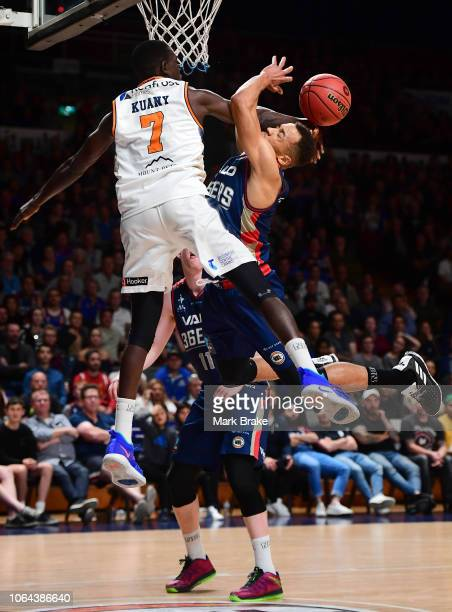 Kuany Kuany of the Taipans blocks Demitrius Conger of the Adelaide 36ers during the round seven NBL match between the Adelaide 36ers and the Cairns...