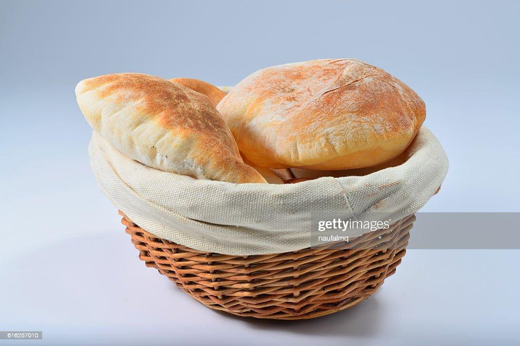 Kuboos or khubz - pita bread in basket : Stock Photo