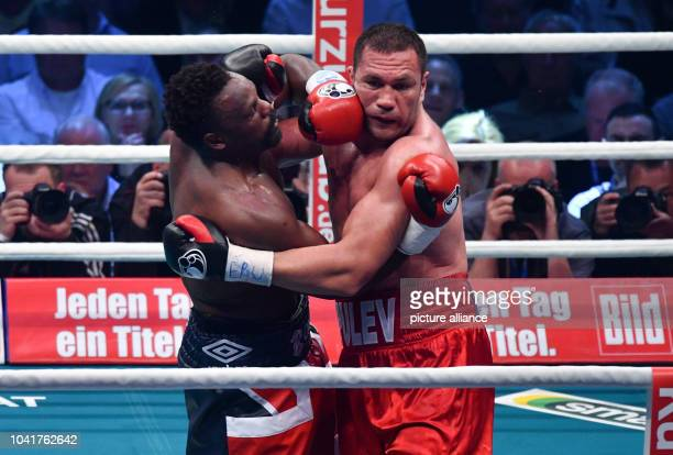 Kubrat Pulev from Bulgaria and Dereck Chisora from England in action during the EBU Heavyweight Championship at BarclaycardArena in Hamburg Germany...