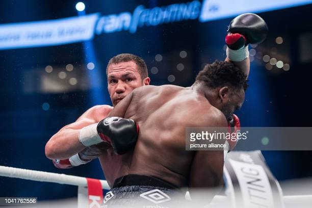 Kubrat Pulev of Bulgaria and Dereck Chisora of Britain in action during their European Heavyweight Championship boxing match in Hamburg Germany 07...
