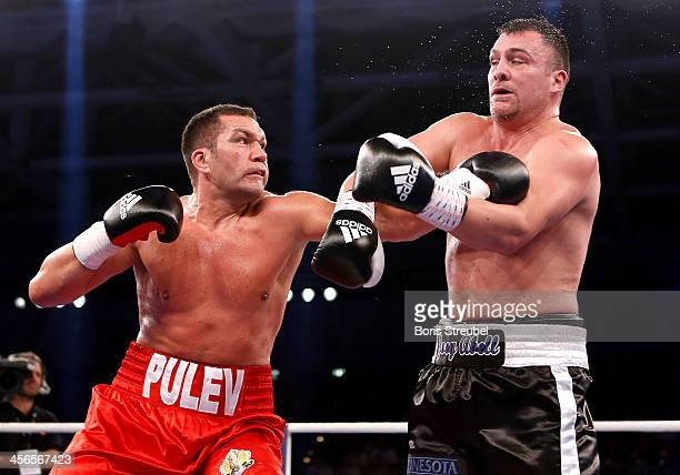 Kubrat Pulev of Bulgaria and Joey Abell of United States exchange punches during their IBF international heavyweight championship fight at...