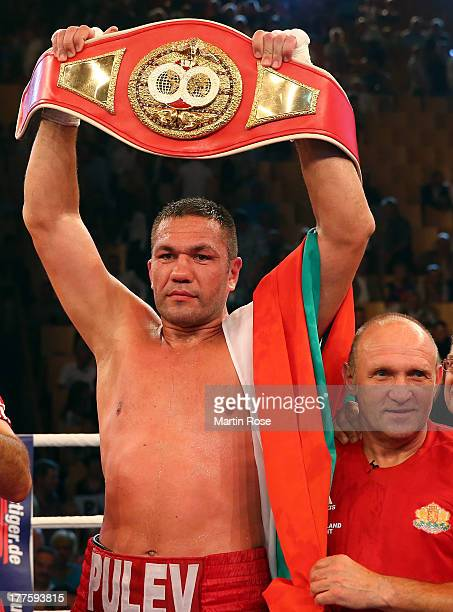 Kubrat Pulev of Bulgaria celebrate with coach Otto Ramin after winning the IBF International heavyweight fight at Sport und Kongresshalle on August...