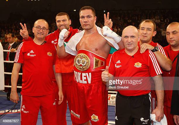 Kubrat Pulev of Bulgaria celebrates with his team after winning his IBF international heavyweight championship fight against Joey Abell of United...