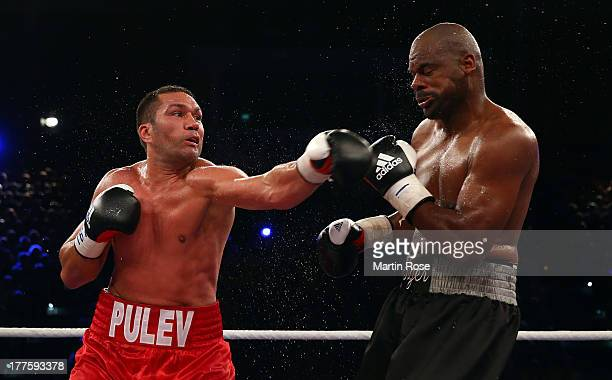 Kubrat Pulev of Bulgaria exchanges punches with Tony Thompson of USA during their IBF International heavyweight fight at Sport und Kongresshalle on...