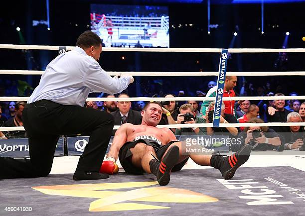 Kubrat Pulev of Bulgaria lies on the floor during their IBF heavy weight title fight between Wladimir Klitschkoat and Kubrat Pulev at O2 World...