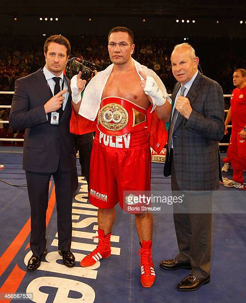 Kubrat Pulev of Bulgaria poses with his managers Kalle and Wilfried Sauerland after winning his IBF international heavyweight championship fight...