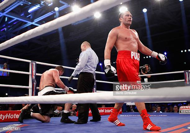Kubrat Pulev of Bulgaria reacts after he knocks out Joey Abell of United States during their IBF international heavyweight championship fight at...