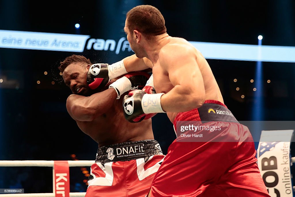 Kubrat Pulev of Bulgaria throws a punch at Dereck Chisora of Great Britain during Heavyweight European Championship between Kubrat Pulev and Dereck Chisora at Barclaycard Arena on May 7, 2016 in Hamburg, Germany.