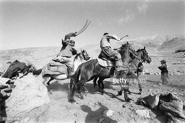 Kuchi men playing 'Buzkashi' a very ancient game from which polo derives