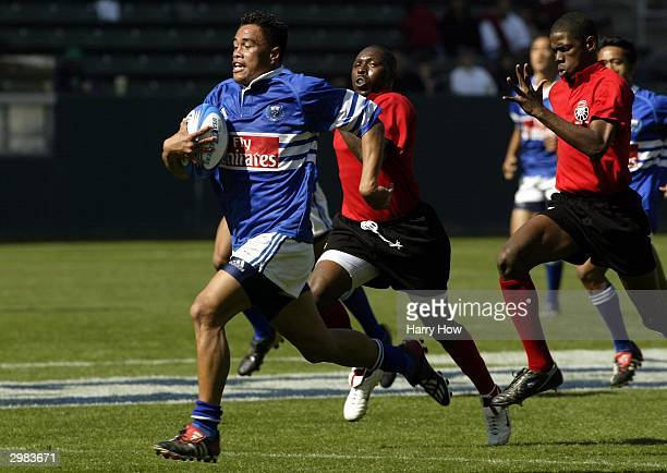 Kueli Danielson of Samoa breaks away to score against Trinidad and Tobago during Game 8 of the IRB Rugby USA Seven Series at the Home Depot Center on...
