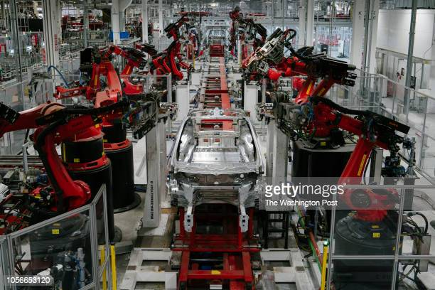 Kuka robots work on Tesla Model X in the Tesla factory in Fremont California on Thursday July 26 2018