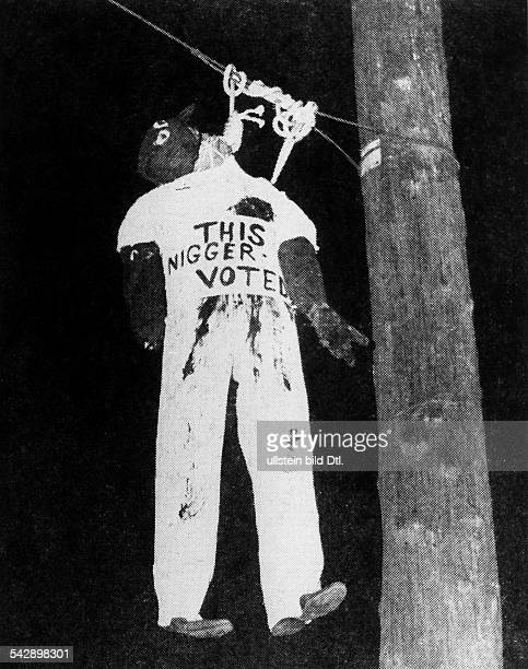 USA KuKluxKlan hanged dummy labled with 'This Nigger voted' no furhter informationin the 20ies