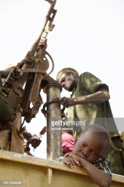 Kuku the son of General Hamza rests his head in a pickup truck while his father's fighters gear up for combat in Heiban Sudan 12 February 2017 The...