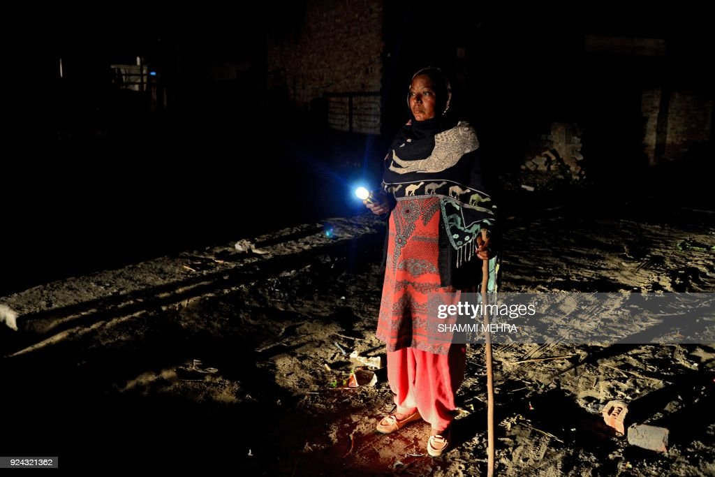 Kuldeep KaurIndian an Indian watchwoman walks with a flashlight during her night round at Bhangiwal village near Mehatpur some 40km south from...