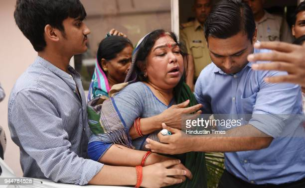 Kuldeep Singh Sengar's wife Sangeeta Sengar reacts after meeting the Directorate General of Police on April 11 2018 in Lucknow India