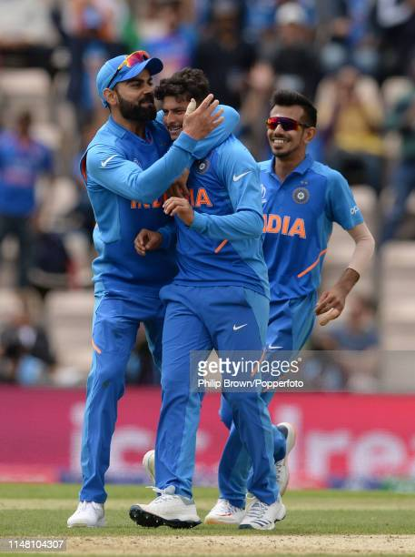 Kuldeep Yadav and Virat Kohli of India celebrate after the dismissal of JP Duminy of South Africa during the ICC Cricket World Cup Group Match...