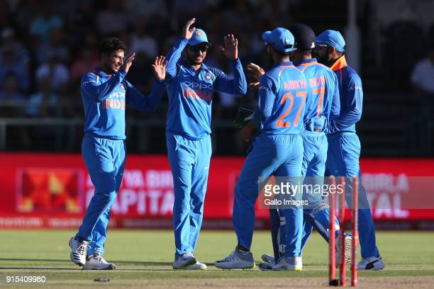 Kuldeep Yadav of India and MS Dhoni of India are congratulated for getting South African captain Aiden Markram wicket during the 3rd Momentum ODI...
