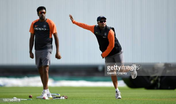 Kuldeep Yadav of India bowls watched by Ravichandran Ashwin during a nets session at Edgbaston on July 30 2018 in Birmingham England