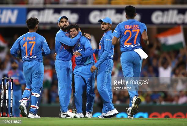 Kuldeep Yadav of India celebrates after taking a catch off his own bowling to dismiss Chris Lynn of Australia during game one of the the...