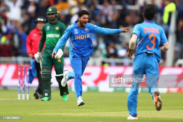 Kuldeep Yadav of India celebrates bowling Babar Azam of Pakistan during the Group Stage match of the ICC Cricket World Cup 2019 between India and...