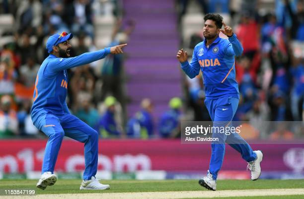 Kuldeep Yadav of India celebrates taking the wicket of JP Duminy of South Africa with Virat Kohli of India during the Group Stage match of the ICC...