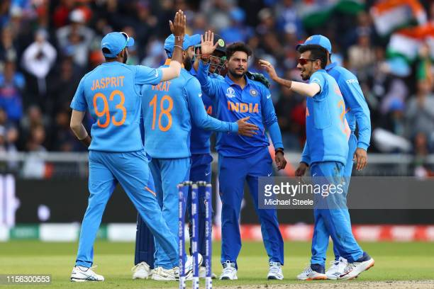 Kuldeep Yadav of India celebrates with team mates after taking the wicket of Fakhar Zaman of Pakistan during the Group Stage match of the ICC Cricket...