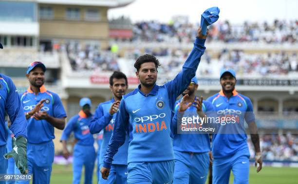 Kuldeep Yadav of India salutes the crowd as he leaves the field after picking up six wickets during the Royal London OneDay match between England and...
