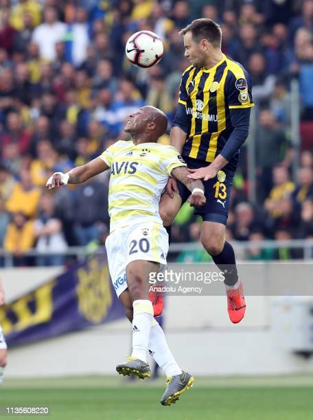 Kulusic of MKE Ankaragucu in action against Ayew of Fenerbahce during Turkish Super Lig soccer match between MKE Ankaragucu and Fenerbahce at Eryaman...