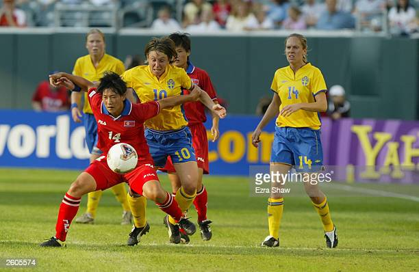 Kum Ran O of Korea DPR fends off forward Hanna Ljungberg of Sweden during their FIFA Women's World Cup match at Lincoln Financial Field on September...