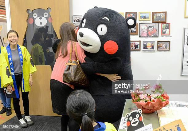 Kumamon hugs with a visitor at its office at Kumamon Square on May 10 2016 in Kumamoto Japan Kumamon the popular bear mascot of Kumamoto Prefecture...