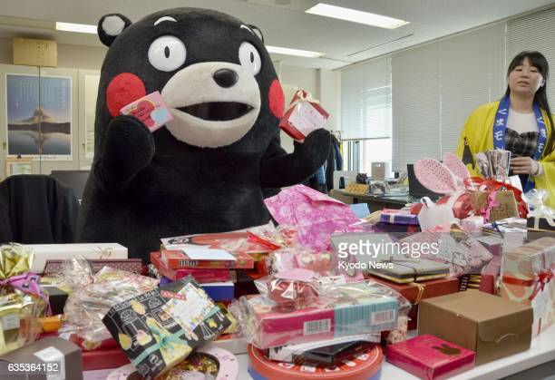 Kumamon the popular black bear mascot of Kumamoto Prefecture holds Valentine's Day chocolates at the prefectural government offices in Kumamoto Japan...