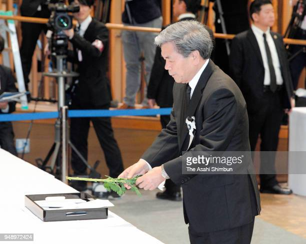 Kumamoto Prefecture Governor Ikuo oKabashima offers flowers during the memorial ceremony on the second anniversary of the Kumamoto Earthquakes on...