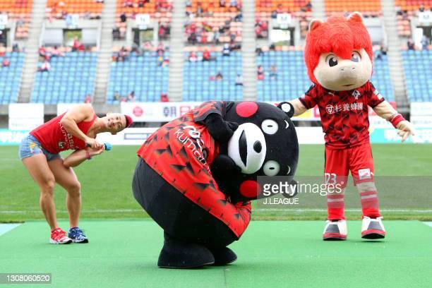 Kumamoto Prefecture mascot Kumamon and Roasso Kumamoto mascot Roasso-kun entertain fans prior to the J.League Meiji Yasuda J3 match between Roasso...