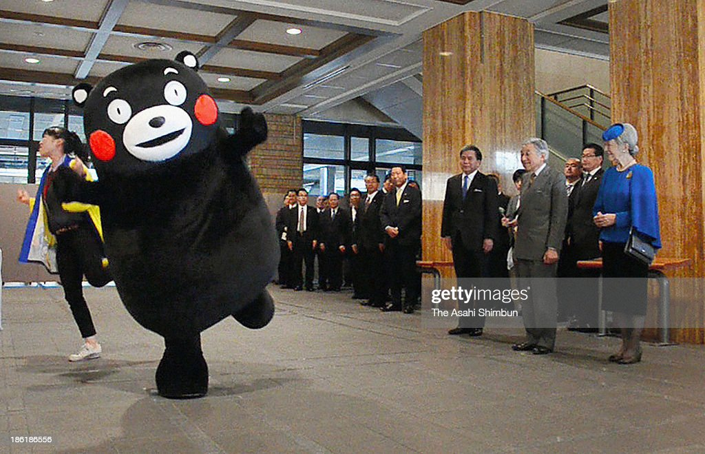Kumamoto Prefecturefs bear-like mascot Kumamon performs its 'Kumamon Exercise' dance for Emperor Akihito and Empress Michiko at the prefectural government office on October 28, 2013 in Kumamoto, Japan. Kumamoto Governor Ikuo Kabashima used exhibition panels to explain what Kumamon does to promote the prefecture. The empress responded by asking the governor, 'Do you have only one Kumamon?'