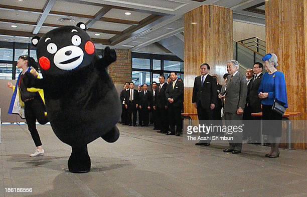 Kumamoto Prefecturefs bear-like mascot Kumamon performs its 'Kumamon Exercise' dance for Emperor Akihito and Empress Michiko at the prefectural...