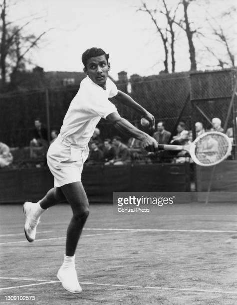 Kumar of India makes a backhand return to Jimmy Tattersall of Great Britain during their Men's Singles match at the Spring Open Hard Court Tennis...