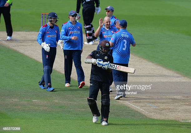 Kumar Sanakkara of Surrey wals off after being caught out by Darren Stevens of Kentoff the bowling of James Tredwell of Kent during the Royal London...