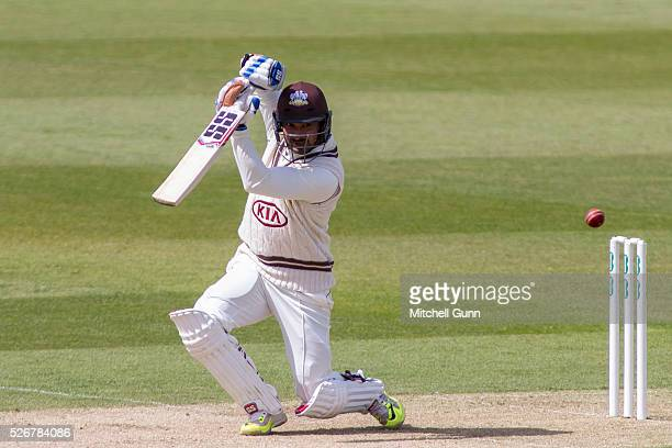 Kumar Sangakara of Surrey hits the ball for four runs during the Specsavers County Championship Division One match between Surrey and Durham at the...